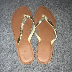 Gold hollister flip flops Good condition run small